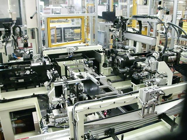 自動両端プレス圧入システム